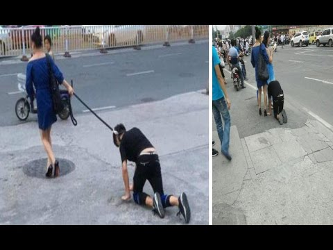 Woman takes her male companion for a walk on a DOG LEASH in China