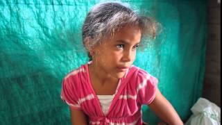 Niña cubana de ojos carmelitas, estilo a McCurry