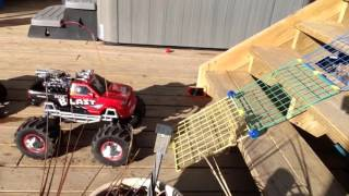 Traxxas stampede and new bright mega blast monster truck climbing stairs