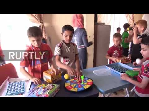 Syria: Russian soldiers bring gifts to Aleppo orphanage on eve of Children's Day