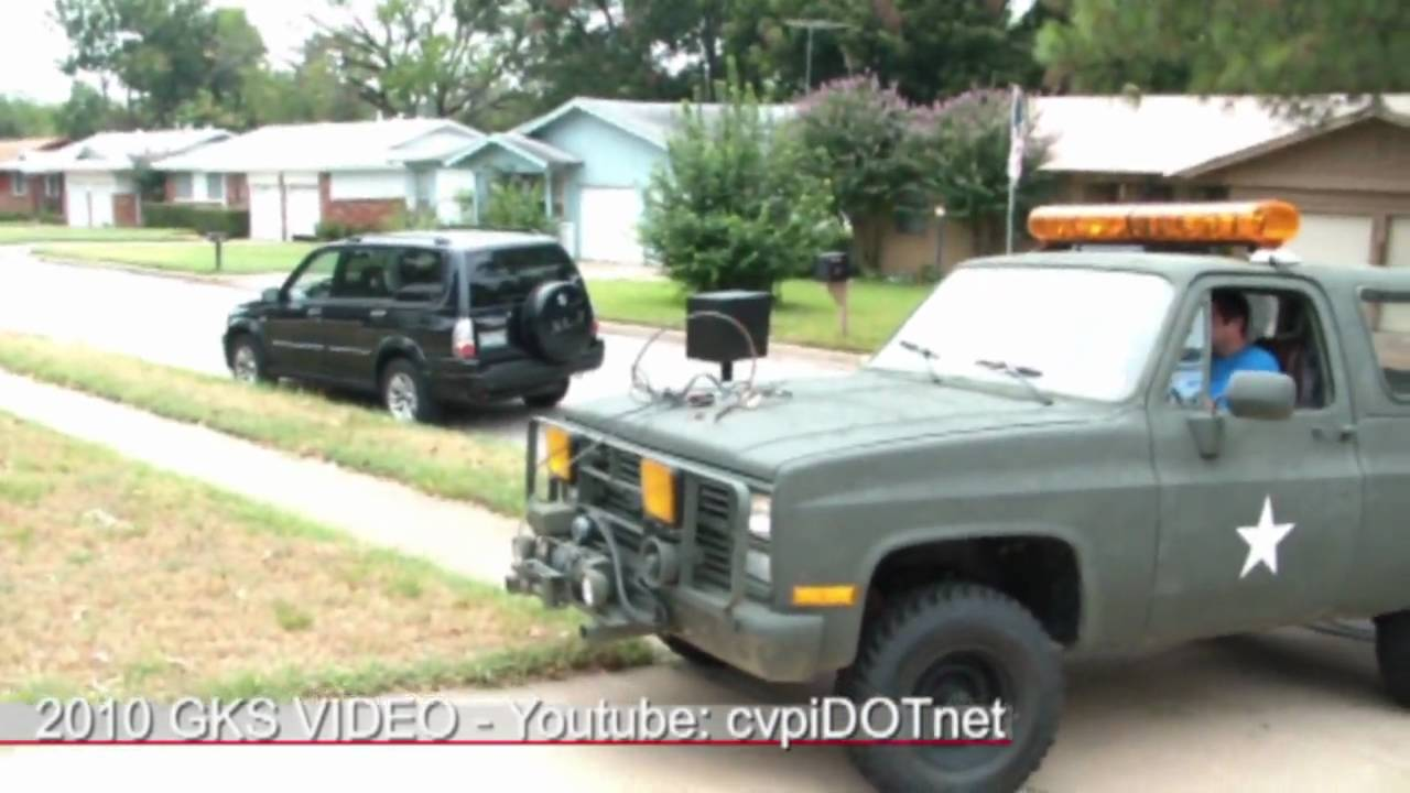Military M1009 CUCV Blazer winch pulling out tree stump ...