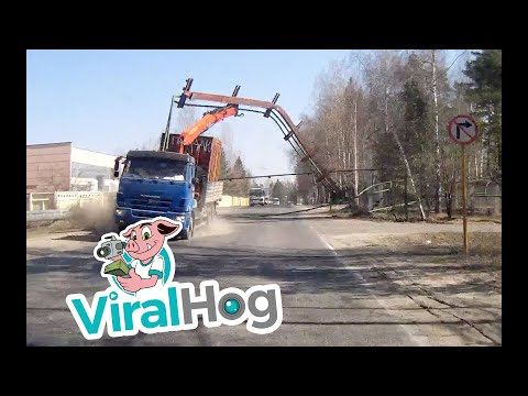 Crane Truck Takes out Overhead Structure || ViralHog
