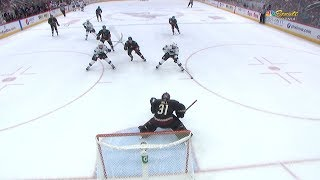 Logan Couture races down Tomas Hertl's pass in the slot for a parti...