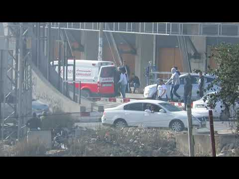 Masked Palestinians Exiting Red Crescent Society Ambulance