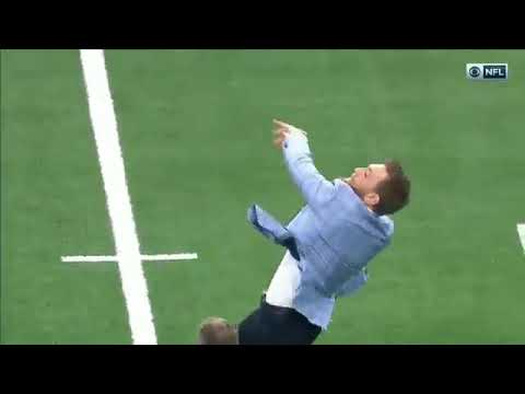 Conor McGregor attempts to throw a football
