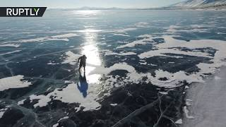 RAW: 76yo Russian grandma commutes on Lake Baikal by ice skates