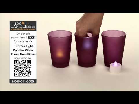 Purple Glass Cylinder Candle Holder With A Variety Of Tea Lights