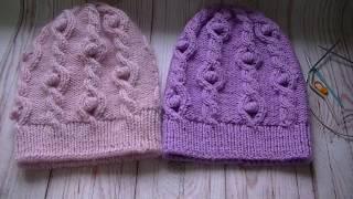 Вязание шапки узором косы с шишечками.