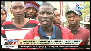 A suspected thief in Kitengela falls in a manhole