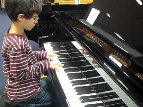 7 years old boy plays piano wonderfully  spinning wheel by blood sweat and tears.