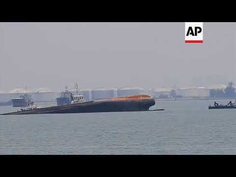 Search for crew of capsized dredger off Singapore
