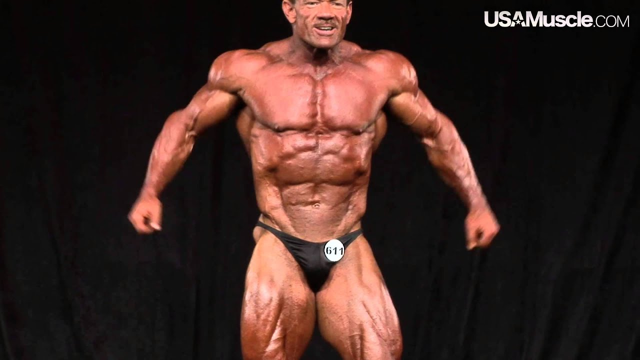 image Bodybuilder mature in training center with high heels