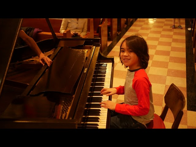 Caitlin (10) performs French Children's Song; Sebastian (10) performs Rockin' Robin, The Locomotion