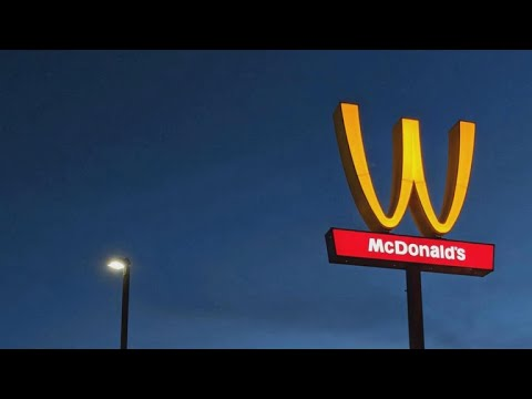 McDonalds sign flips golden arches upside down to create a W for women