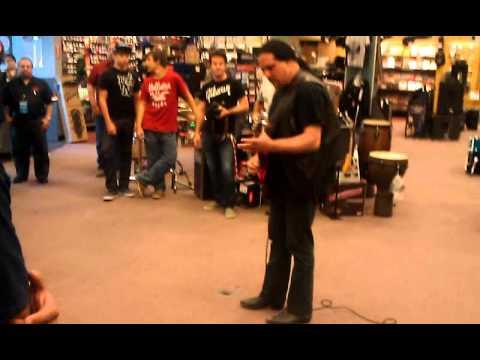 Guy demos Firebird X at Guitar Center