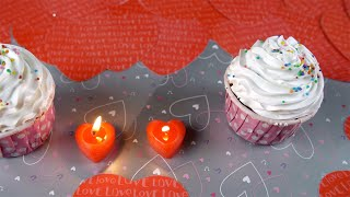 Top view shot of valentine's cupcakes with burning candles - romantic love concept