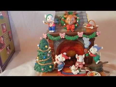 Animated Christmas Scene of elf-mice stringing lights with music box