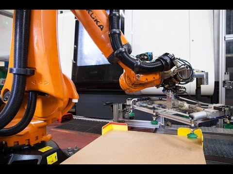 KUKA KR QUANTEC loading and unloading a DMG Mori machine tool