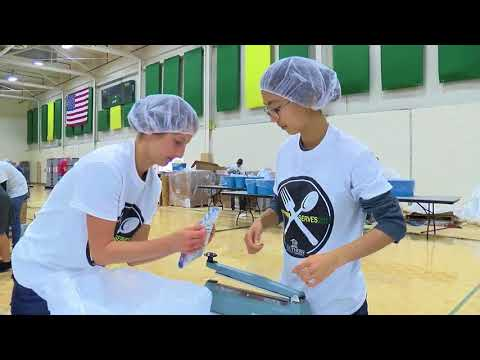 Southern Adventist University students, volunteers, pack thousands of meals Sunday