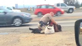 Officer caught on camera punching woman