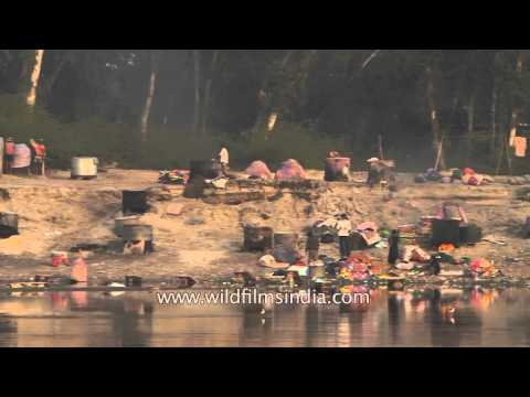 Open-air laundromats on banks of River Yamuna