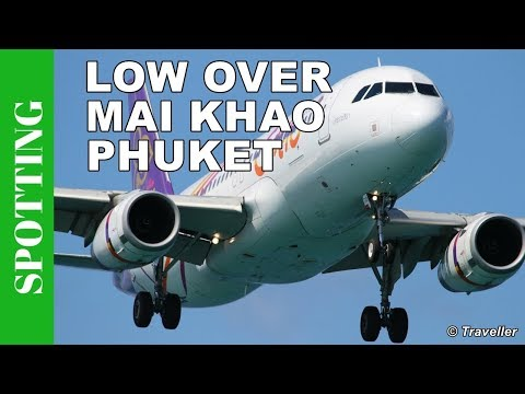 Low landing Thai Smile Airbus A320 at Phuket Airport  – Mai Khao Beach in Phuket