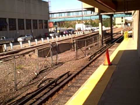 MBTA Orange Line 01200s train inbound to Boston at Wellington.