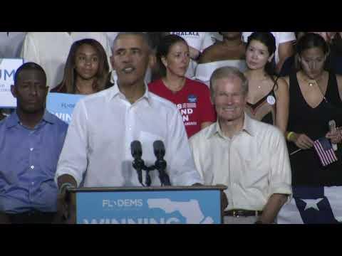 Obama slams divisive rhetoric; heckler cuts in