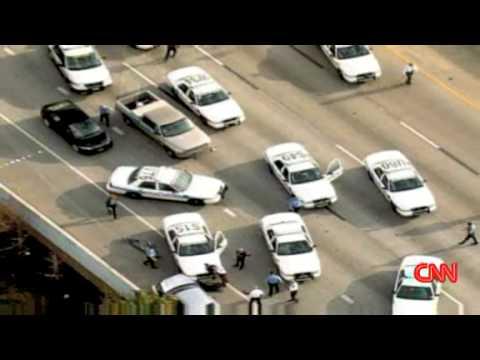 CNN: driver flips over police car