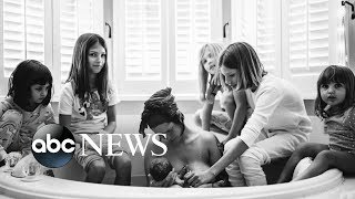 5 daughters surround mom as she gives birth to their baby sister