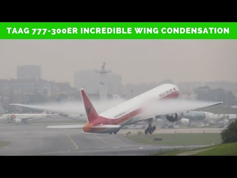 TAAG Boeing 777 300er incredible WING CONDENSATION on takeoff