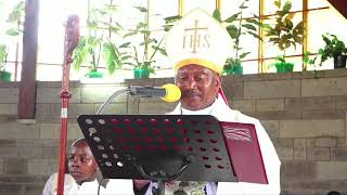 A reverend sings kamaru song to a newly wed couples