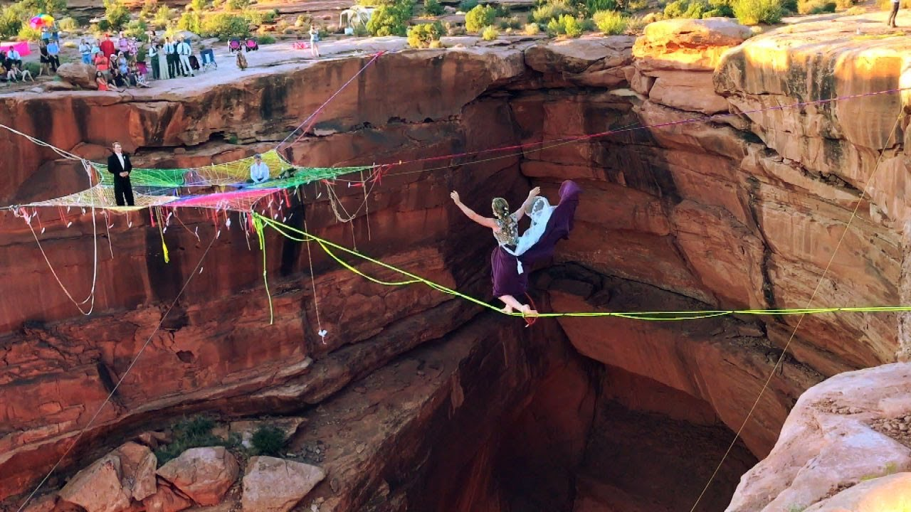 bride and groom slackline 400 feet above canyon floor to their