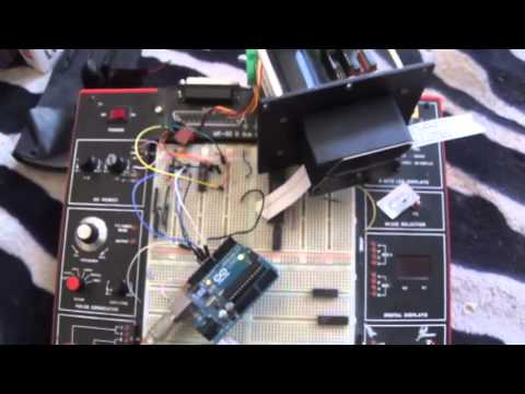 Paper tape reader unit motor controlled by Arduino.