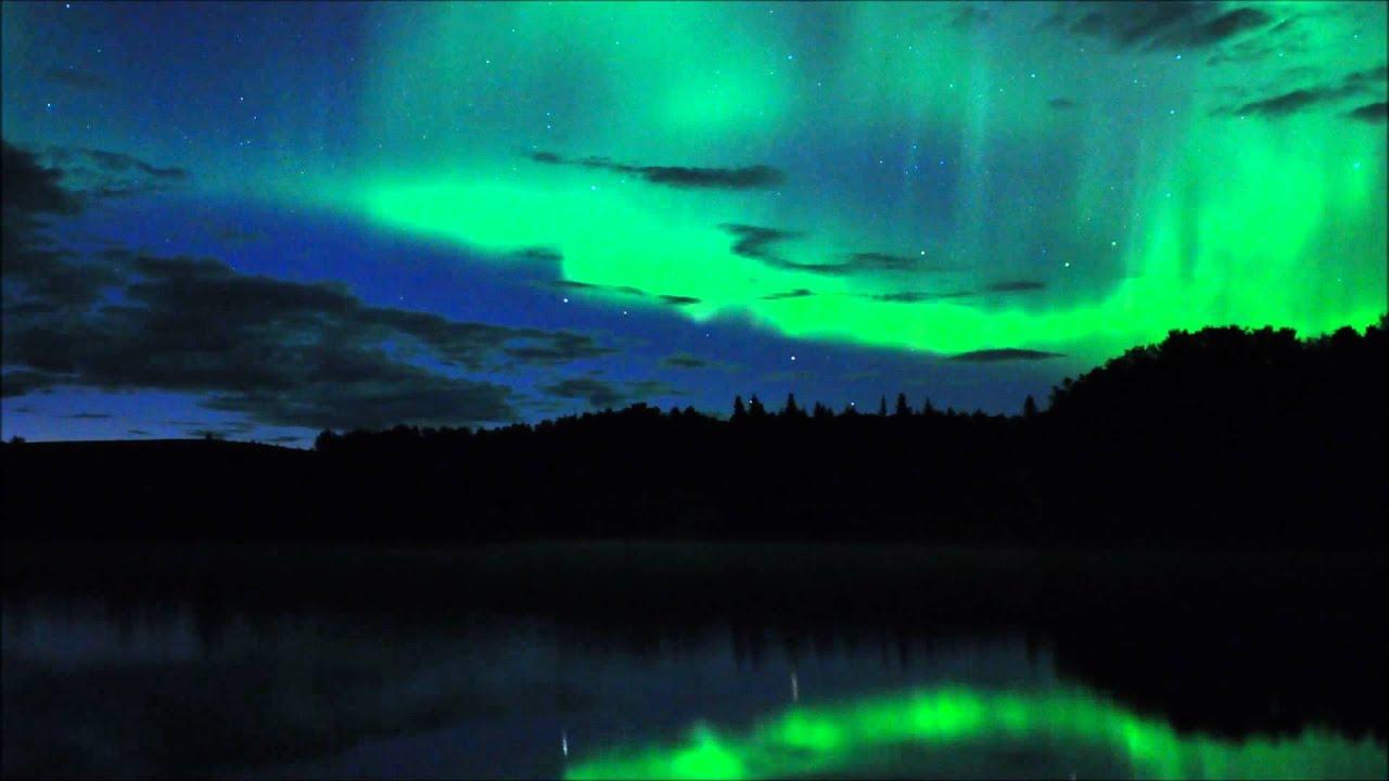 Northern lights mirrored on Olnes Pond Alaska August