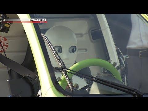 Humanoid Robot Drives A Car... Slowly