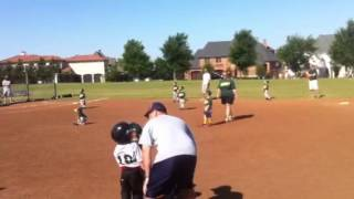 Avery playing T-ball