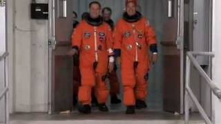 STS-128 Discovery Crew Walk Out To Astrovan