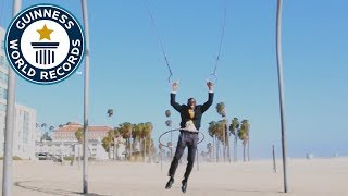 Longest distance swinging on rings while hula hooping - Guinness World Records