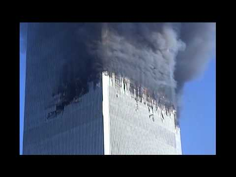 NIST FOIA 09-42: R27 -- 42A0240 - G26D115 (Twin Towers Burning/WTC2 Impact Zone, SE View)