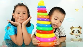 Coco Pretend play with Rainbow Tower Stacking Ring Learn Colors For Children Indoor Playground