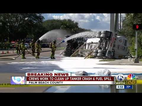 Crews work to clean up taker crash and fuel spill