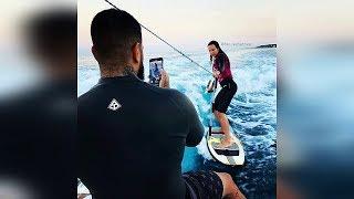 Тимати учит Решетову серфить по волнам а Алисса помогает