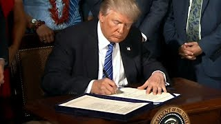Watch Now: President Trump signs the John S. McCain National Defense Authorization Act for 2019