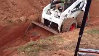 Bobcat 863-C Turbo Skid steer digging 5Ft.hole with new bucket teeth