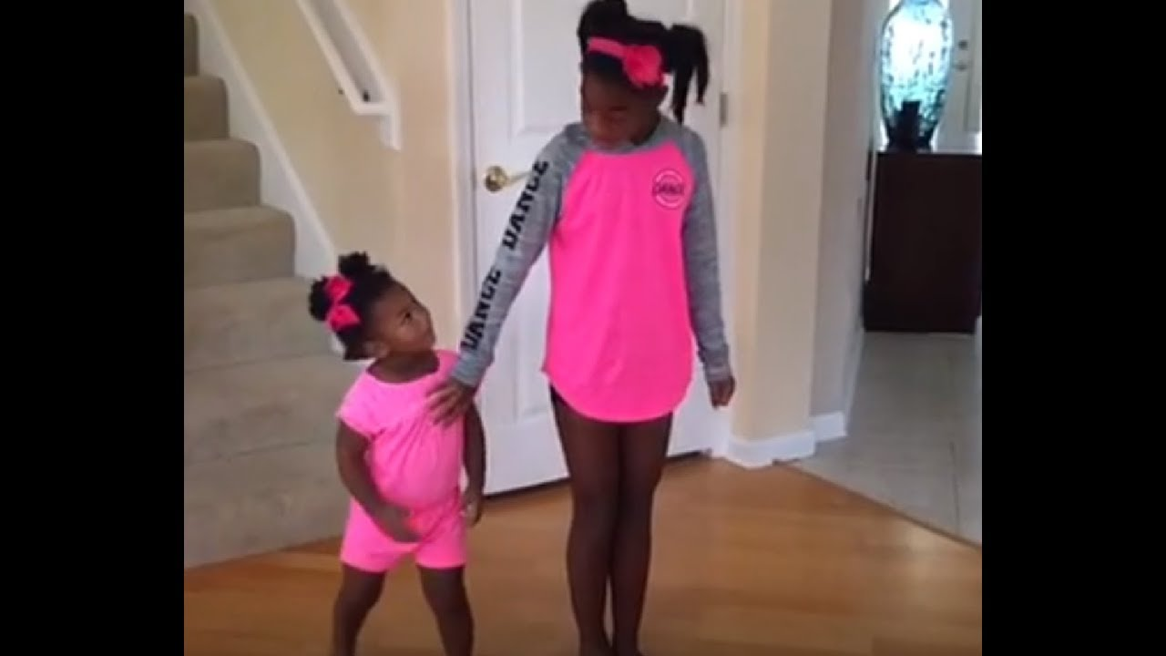 Girl wants solo dance, but baby sister steals the show!