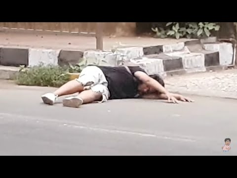 Getting Fainted On The   Road Prank Video.