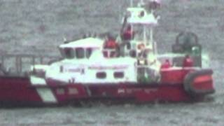 Canadian Coast Guard Ship cleaning buoy off Salt Spring Island