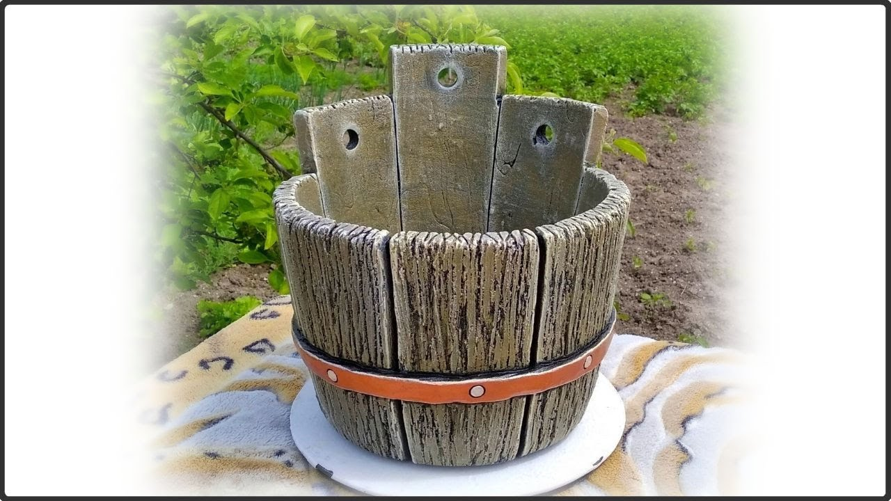 Cement mortar, sand form, added details and turned out to be a chic concrete flowerpot for garden