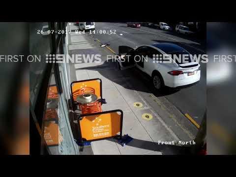 Tesla Model X door torn off by passing truck